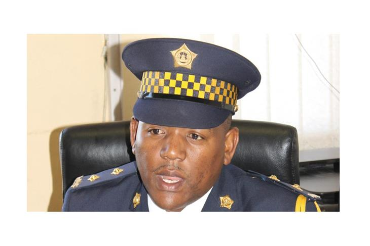 A member of Lesotho police finds a human skull in a pile of sand.<br/>A member of Lesotho police finds a human skull in a pile of sand.<br/>A member of Lesotho police finds a human skull in a pile of sand.