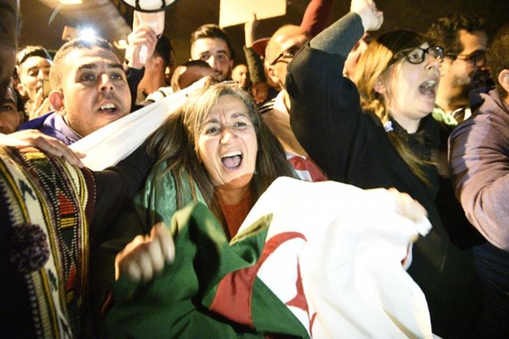 Algerians demand a sweeping change in Algeria's political system.