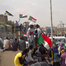 Thousands of Sudanese call for dissolving Bashir's party.